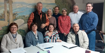 2015 Executive Board: Judy Austic, Sigrid Connors, Robin Carlisle Peck, David Priester; standing: Roger Hopkins, Sheila Stone, John Andersson, Carol Mallison, Paul Warrender, Gary Mallow; invisible: Marsha Zgola; not present: Lincoln Brown, Jim Connors, Barbara Nussbaum, Barbara Moreley - Photo: M. Zgola