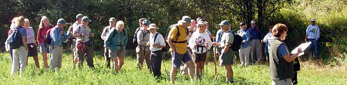 Volunteer hike leader checks in the hikers
